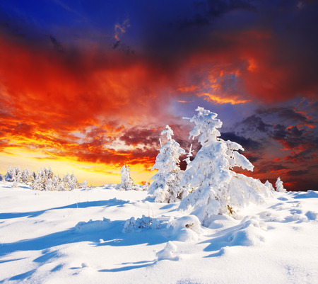 Majestic sunset in the winter mountains landscape. HDR image Stock Photo