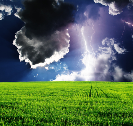 Thunderstorm with lightning in green meadow. Dramatic sky. Stock Photo - 81568488