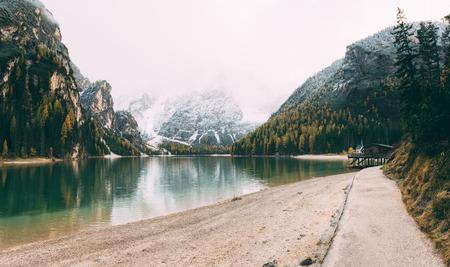 Great scene the alpine lake Braies (Pragser Wildsee). Location place Dolomiti national park Fanes-Sennes-Braies, Italy.