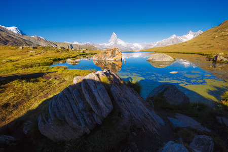 Great  panorama with famous peak Matterhorn in alpine valley. Location place Swiss alps, Stellisee, Valais region, Europe.