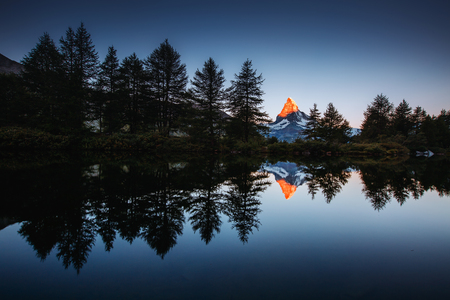 Morning panorama with famous peak Matterhorn in alpine valley. Location place Swiss alps, Grindjisee, Valais region, Europe. Stock Photo
