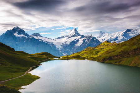 Panorama of Mt. Schreckhorn and Wetterhorn. Location place Bachalpsee in Swiss alps, Bernese Oberland, Grindelwald, Europe.