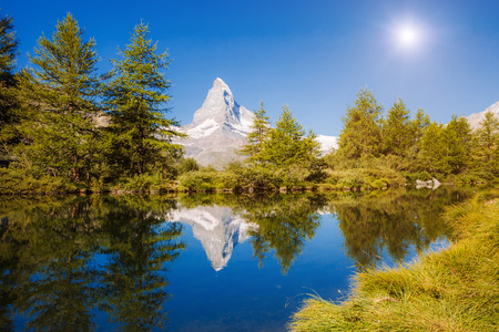 Great panorama with famous peak Matterhorn in alpine valley. Location place Swiss alps, Grindjisee, Valais region, Europe. Stock Photo