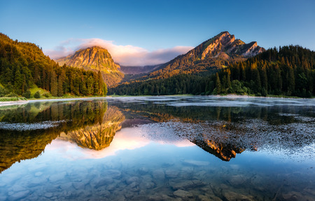 Majestic view of alpine pond Obersee at twilight. Location famous place Nafels, Mt. Brunnelistock, Swiss alps, Europe. Stock Photo