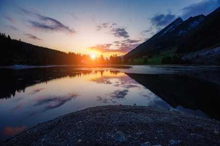 Majestic view of alpine pond Obersee at twilight. Popular tourist attraction. Location famous place Nafels, Mt. Brunnelistock, Swiss alps, Europe.