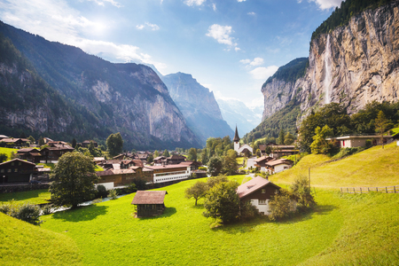 Great view of alpine village glowing by sunlight. Picturesque and gorgeous scene. Location place Swiss alps, Lauterbrunnen valley, Staubbach waterfall, Europe.
