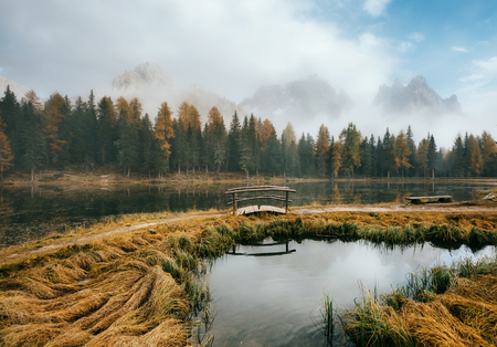 Great view of the foggy lake Antorno in National Park Tre Cime di Lavaredo. Location Auronzo, Misurina, Dolomiti alps, South Tyrol, Italy, Europe. Vintage style. Stock Photo