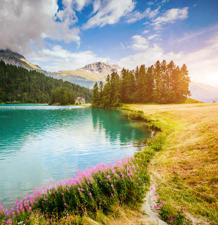 Great view of the azure pond Champfer in alpine valley. Picturesque and gorgeous scene. Location Swiss alps, Silvaplana village. Europe. Retro and vintage style. Imagens