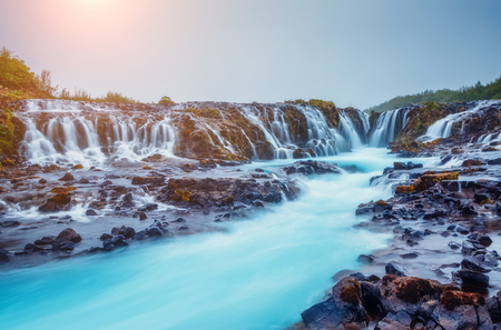 Dramatic views of the bright powerful Bruarfoss waterfall. Popular tourist attraction. Unusual and picturesque scene. Location place South Iceland, Europe. Artistic picture. Beauty world. Stock Photo