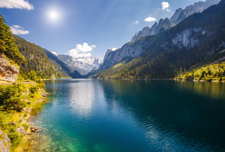 Great azure alpine lake Vorderer Gosausee. Picturesque and gorgeous morning scene. Salzkammergut is a famous resort area located in the Gosau Valley in Upper Austria. Dachstein glacier. Beauty world. Stock Photo