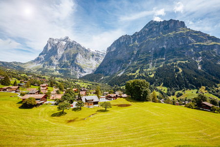 Impressive view of alpine Eiger village. Picturesque and gorgeous scene. Popular tourist attraction. Location place Swiss alps, Grindelwald valley in the Bernese Oberland, Europe. Beauty world. Stock Photo