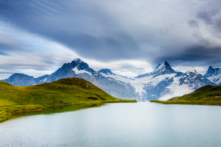 Great view of Mt. Schreckhorn and Wetterhorn above Bachalpsee lake. Dramatic and picturesque scene. Popular tourist attraction. Location Swiss alp, Bernese Oberland, Grindelwald, Europe. Beauty world Stock Photo