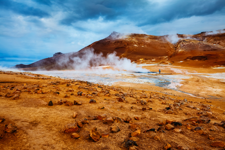 Ominous view geothermal area Hverir (Hverarond). Popular tourist attraction. Dramatic and picturesque scene. Location place Lake Myvatn, Krafla northeastern region of Iceland, Europe. Beauty world. Foto de archivo