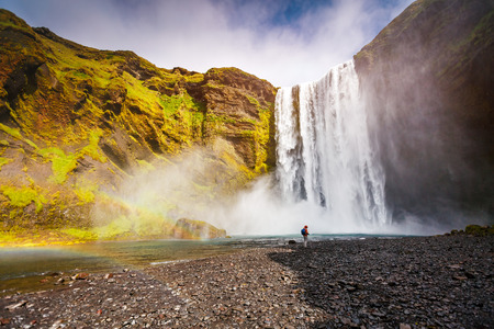 Great view of Skogafoss waterfall and scenic surroundings. Dramatic and picturesque scene. Popular tourist attraction. Location famous place Skoga river, highlands of Iceland, Europe. Beauty world. Stock Photo