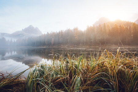 Great view of the foggy lake Antorno in National Park Tre Cime di Lavaredo. Location Auronzo, Misurina, Dolomiti alps, South Tyrol, Italy