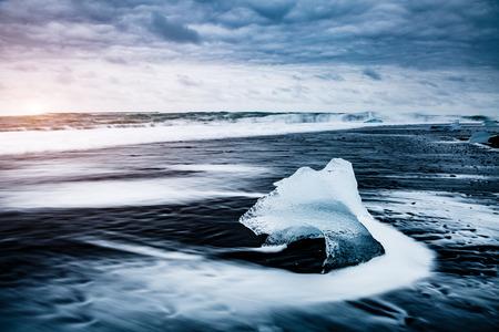 Large pieces of the iceberg that sparkle on the black sand. Picturesque and gorgeous scene. Location famous place Jokulsarlon lagoon, Vatnajokull national park, island Iceland, Europe. Beauty world. Stock Photo