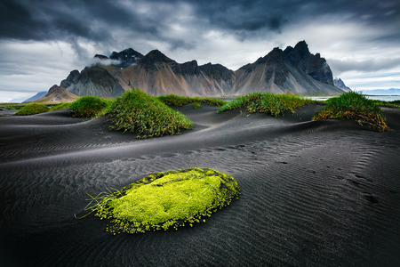 Great wind rippled beach black sand. Picturesque and gorgeous scene. Popular tourist attraction. Location famous place Stokksnes cape, Vestrahorn (Batman Mountain), Iceland, Europe. Beauty world. Stockfoto