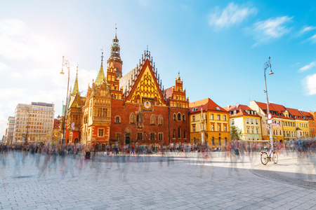Fantastic view of the ancient city hall Wroclaw (Ratusz Wrocławski) on a sunny day. Picturesque scene. Location famous Market Square, Poland