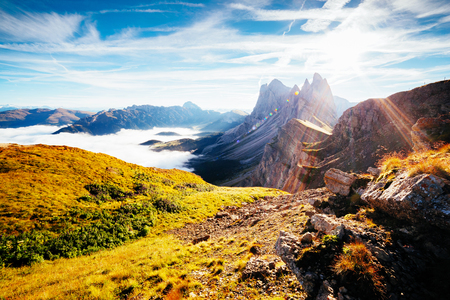 Aerial view of the alpine valley in sunlight. Great and gorgeous morning scene. Location place Puez-Odle National Park, Gardena, Seceda peak, Geisler Dolomiti group. Tyrol, Italy Stock Photo - 89925999