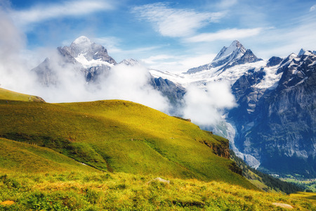 Great view of alpine snowy hills. Picturesque and gorgeous scene. Popular tourist attraction. Location place Swiss alps, Grindelwald valley, Bernese Oberland, Europe.