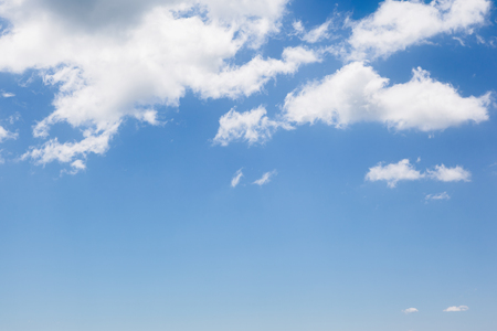 Fantastic view of the azure sky on a sunny day with fluffy clouds. Stock Photo