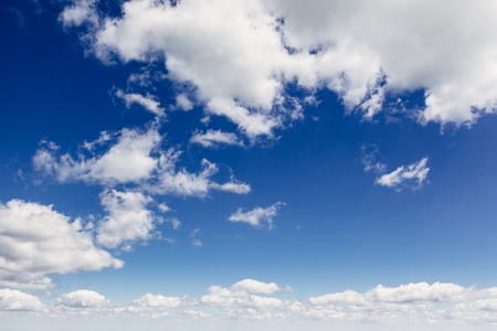 Fantastic view of the azure sky on a sunny day with fluffy clouds. Imagens