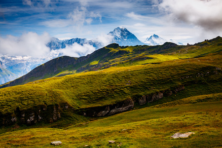 Great view of alpine hill. Picturesque and gorgeous scene. Popular tourist attraction. Location place Swiss alps, Grindelwald valley in the Bernese Oberland, Europe. Stock Photo
