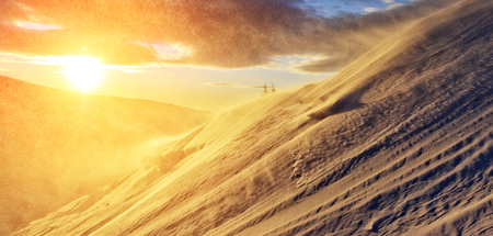 Exotic view of the snow dune in yellow light. Dramatic and gorgeous morning scene. Location place Carpathian, Ukraine, Europe.