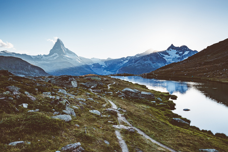 Scenic surroundings with famous peak Matterhorn in alpine valley. Popular tourist attraction. Dramatic and picturesque scene. Location place Swiss alps, Stellisee, Valais region, Europe.