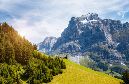 Impressive view of alpine Eiger village. Picturesque scene. Popular tourist attraction. Location place Swiss alps, Grindelwald valley in the Bernese Oberland, Europe. Stock Photo
