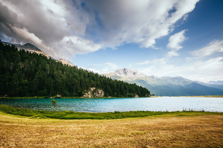 Great view of the azure pond Champfer in alpine valley. Picturesque and gorgeous scene. Location Swiss alps, Silvaplana village. Europe.