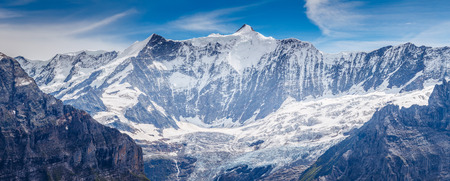 Great view of the snowy massive rock in sunlight. Picturesque and gorgeous scene. Location place Swiss alps, Grindelwald valley, Bernese Oberland, Europe. Stock Photo