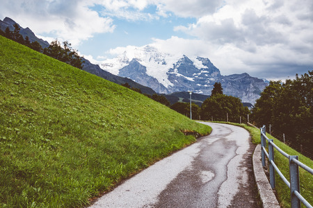 Scenic surroundings near the resort Wengen. Great and gorgeous scene. Famous tourist attraction. Location place Swiss alp, Lauterbrunnen valley, Bernese Oberland, Europe.