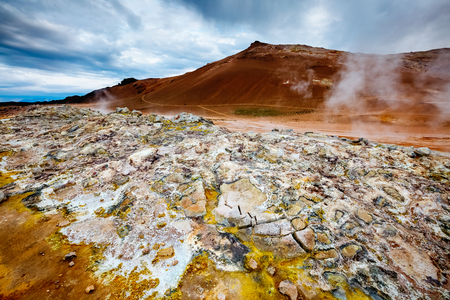 Ominous view geothermal area Hverir (Hverarond). Popular tourist attraction. Dramatic and picturesque scene. Location place Lake Myvatn, Krafla northeastern region of Iceland, Europe. Beauty world. 스톡 콘텐츠