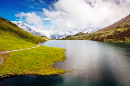 Panorama of Mt. Schreckhorn and Wetterhorn above Bachalpsee lake. Dramatic and picturesque scene. Popular tourist attraction. Location Swiss alps, Bernese Oberland, Grindelwald, Europe. Beauty world. Stock Photo