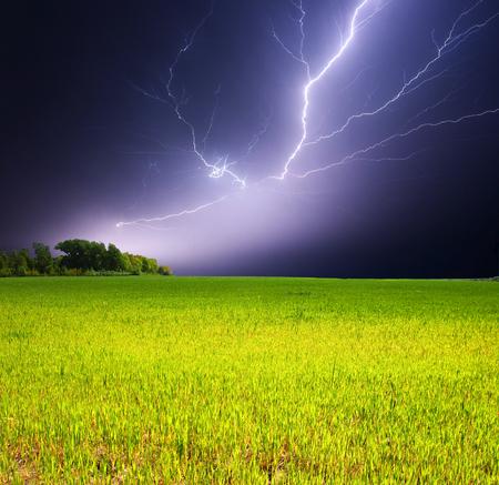 Lightning strike over a field