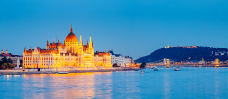 View of great Hungarian Parliament with famous Margit bridge. Popular tourist attraction. Dramatic and picturesque scene. Location place Budapest, Hungary, Europe. Artistic picture. Beauty world.