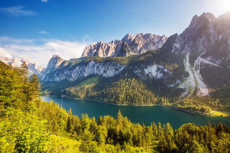 Great azure alpine lake Vorderer Gosausee. Picturesque and gorgeous morning scene. Salzkammergut is a famous resort area located in the Gosau Valley in Upper Austria. Dachstein glacier. Beauty world. Фото со стока
