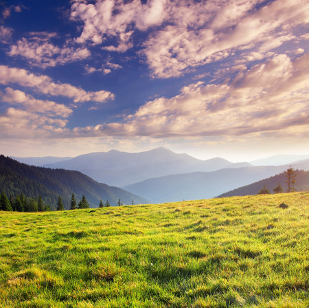 Beautiful mountains landscape and cloudy sky Stock Photo