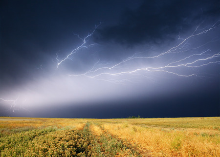summer storm beginning with lightning Stock Photo - 95599256