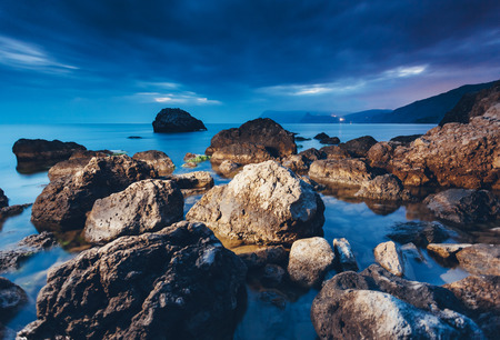 Magic sea in the evening light on a gloomy sky. Dramatic and gorgeous scene. Location place Black Sea, Crimea, Ukraine, Europe. Blue toning effect. Artistic picture. Discover the world of beauty. Stock fotó