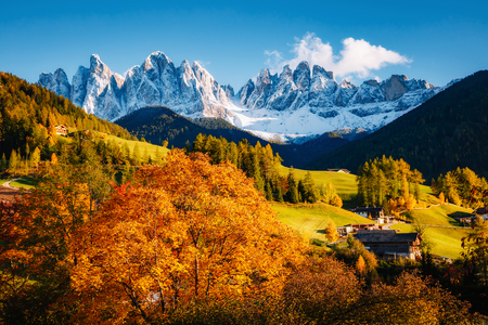 Misty morning in Santa Magdalena village. Picturesque and gorgeous scene. Location famous place Val di Funes, Trentino Alto Adige, Odle Group, Dolomites Alp. Bolzano, South Tyrol, Italy. Beauty world.