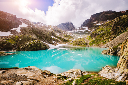 Vivid hills in the day light on Lac Blanc (White Lake). Picturesque and gorgeous scene. Location place Chamonix resort, Nature Reserve Aiguilles Rouges, Graian Alps, France, Europe. Beauty world.