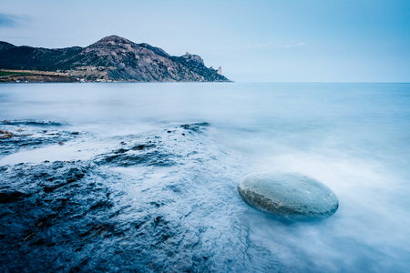 Blue sea in the morning light. Dramatic and gorgeous scene. Location place Black Sea, Crimea, Ukraine, Europe. Cross process filter, retro and vintage style Stock Photo