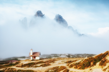 Foggy view of the National park Tre Cime di Lavaredo with rifugio Locatelli. Dramatic and gorgeous scene. Location place famous resort Auronzo, Dolomiti alps, South Tyrol, Italy, Europe. Beauty world. 写真素材