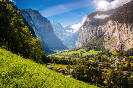 Vivid view of alpine village glowing by sunlight. Picturesque and gorgeous scene. Popular tourist attraction. Location place Swiss alps, Lauterbrunnen valley, Staubbach waterfall, Europe. Beauty world