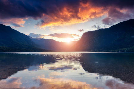 Fantastic mountain lake in Triglav national park at twilight. Dramatic and gorgeous morning scene. Location place Bohinj Valley of the Julian Alps, Slovenia, Europe. Discover the world of beauty.