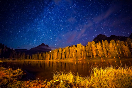 Cadini di Misurina range and Antorno lake under starry light in Natural park Tre Cime di Lavaredo. Dolomiti, South Tyrol. Location place Auronzo, Italy alps, Europe. Astrophotography. Beauty world. Stock Photo
