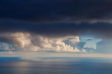 Fantastic view of the dark overcast sky. Dramatic and mystery morning scene. Location: cape Cape Zafferano. Island Sicilia, Italy, Europe. Mediterranean and Tyrrhenian sea. Beauty world.