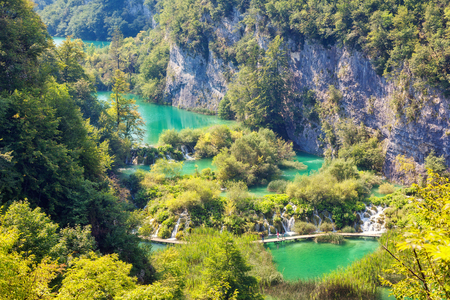 Majestic view on turquoise water in sunny day. Picturesque and gorgeous scene. Popular tourist attraction. Location famous resort Plitvice Lakes National Park, Croatia, Europe. Beauty world.